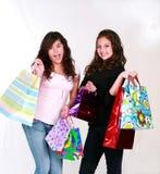 Adolescencias con los bolsos del regalo fotografía de archivo libre de regalías