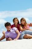 Adolescencias en la playa Fotografía de archivo libre de regalías