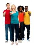 Adolescencias jovenes felices que gesticulan los pulgares para arriba Imágenes de archivo libres de regalías