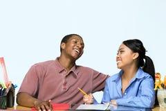 Adolescencias que toman las notas - horizontales Fotografía de archivo libre de regalías