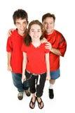 Adolescencias y papá en rojo Imagenes de archivo