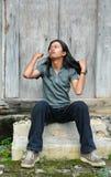 adolescent asiatique de cheveu de fixation Images stock