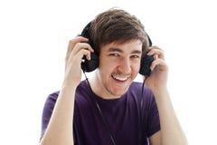 Adolescent avec des écouteurs Photo libre de droits