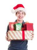 Adolescent avec des cadeaux de Noël image stock