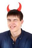Adolescent avec des klaxons de diable Images libres de droits