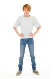 Adolescent avec des mains sur des gratte-culs photo stock