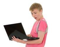 Adolescent avec l'ordinateur portatif Photos stock