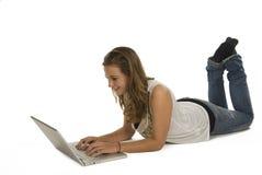 Adolescent avec l'ordinateur portatif Photographie stock libre de droits