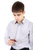Adolescent avec la carte de crédit images stock