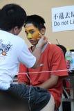 Adolescent avec la peinture de visage de tigre Images stock