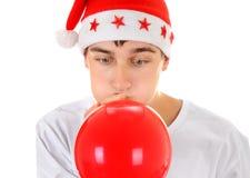 Adolescent avec le ballon rouge Photo libre de droits