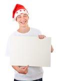 Adolescent avec le conseil blanc Images stock