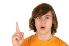 Adolescent avec le doigt soulevé Image stock