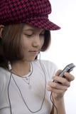 Adolescent avec le MP3 Images libres de droits