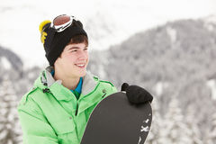 Adolescent avec le Snowboard des vacances de ski Image stock