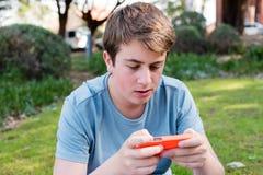Adolescent avec le téléphone intelligent Images stock