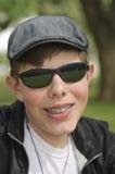 Adolescent avec les supports dentaires Photographie stock libre de droits