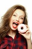 Adolescent avec un beignet Photographie stock