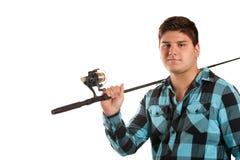 Adolescent avec une pêche Pôle Photo stock