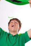 Adolescent bel heureux en vert Images stock