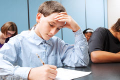 Adolescent Boy - School Test. Adolescent middle school boy concentrats on a standardized test in school royalty free stock image