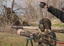 Adolescent Boy Shooting Pistol Royalty Free Stock Photos