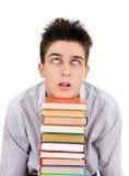 Adolescent contrarié avec les livres Photographie stock libre de droits