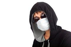 Adolescent dans le masque image stock