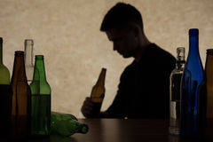 Adolescent drinking beer Stock Photography
