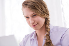 Adolescent female using computer Stock Photos