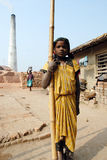 Adolescent girl in brick-field Stock Images