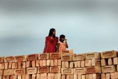 Adolescent girl in brick-field Stock Photo