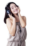 Adolescent girl enjoy music Stock Images