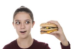 Young Girl with a hamburger Stock Image