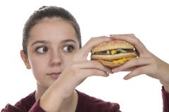 Young Girl with a hamburger Stock Photos