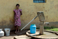 Adolescent Girl in rural India. June 22,2011 Santiniketan,Birbhum,West Bengal,India,Asia- An adolescent girl waiting behind of the tube-well Royalty Free Stock Photography