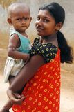 Adolescent Girl in rural India. September 05, 2011.Bolepur,Birbhum,West Bengal,India,Asia-An adolescent girl holding a girl child at remote village of West Royalty Free Stock Image