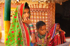 Adolescent Girl in rural India. February 19, 2012-Gujarat,Ran of kutch,India,Asia-Three adolescent Lambada girl in their traditional hut Royalty Free Stock Photography
