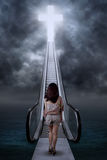 Adolescent girl walking to the heaven Stock Photography