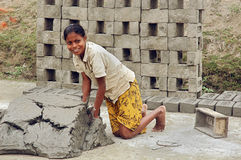Adolescent girls at the brick field. January 10,2011 Hasnabad,West Bengal,India,Asia-A adolescent girl is preparing the raw bricks at the brick-field. Life has royalty free stock photography