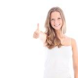 Adolescent heureux renonçant à des pouces Images stock