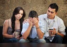 Adolescent mâle triste avec des parents Photo libre de droits