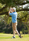 Adolescent Playing Golf Stock Photos