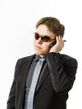 Adolescent posant comme un garde avec l'émetteur radioélectrique Image stock