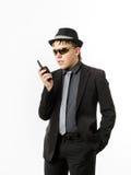 Adolescent posant comme un garde avec l'émetteur radioélectrique Images stock