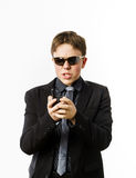 Adolescent posant comme un garde avec l'émetteur radioélectrique Photographie stock