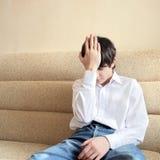 Adolescent préoccupé Image stock