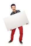 Adolescent retenant l'affiche blanc Photos stock
