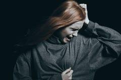 Adolescent sentant un chagrin d'amour Images stock