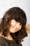 Adolescent shy Asian Girl. Adolescent asian asian feel shy, scratching her curved hair stock photography